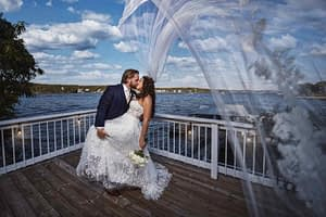 Couple having wedding pictures taken on a deck overlooking lake of the Ozarks in Missouri