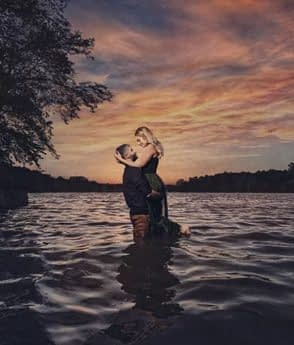 Engagement photogrpahy with couple hugging the water at Lake of the Ozarks