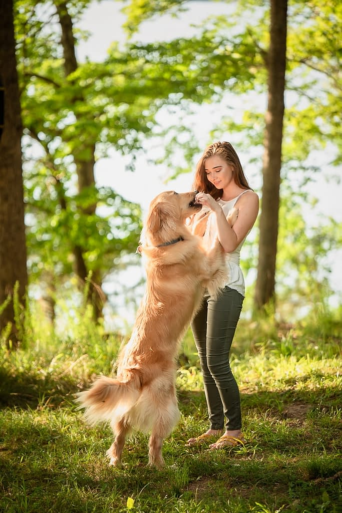 A girl and her dog during a senior photo session at the Lake of the Ozarks