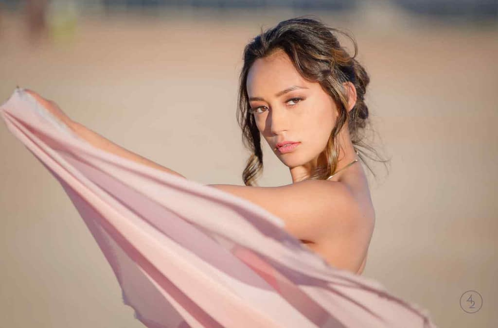 Creative senior picture ideas with a pink flowing scarf made this girl look amazing!