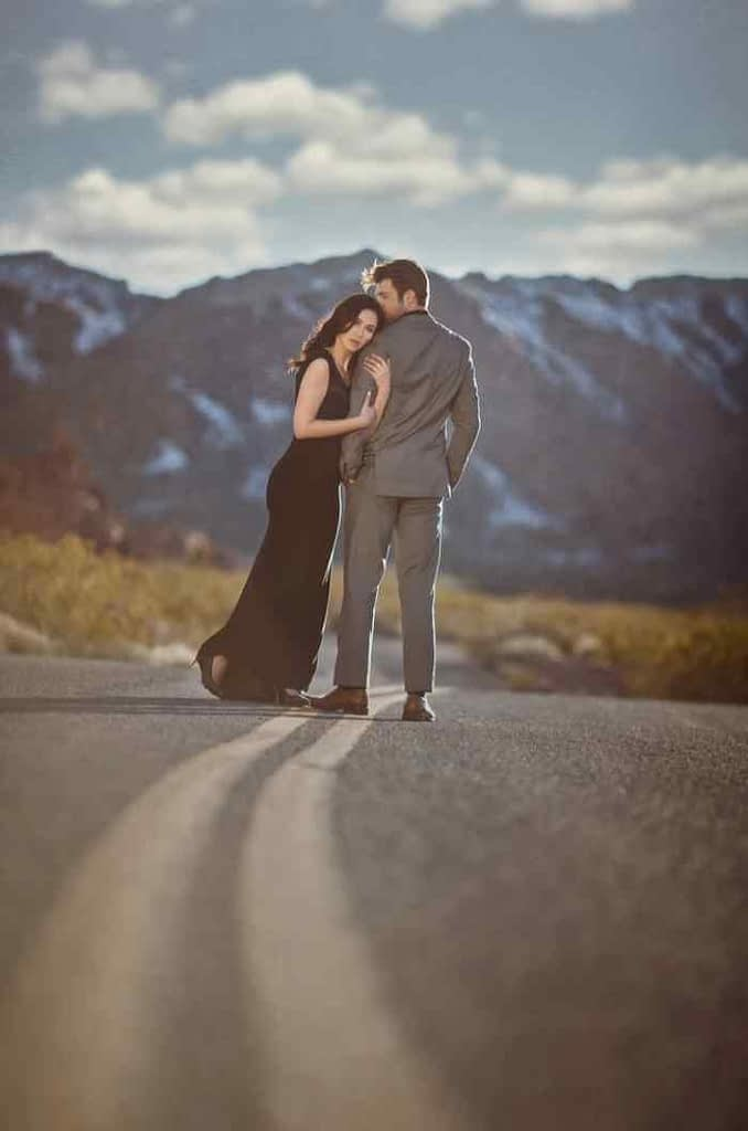 Romantic engagement picture with mountains in the background
